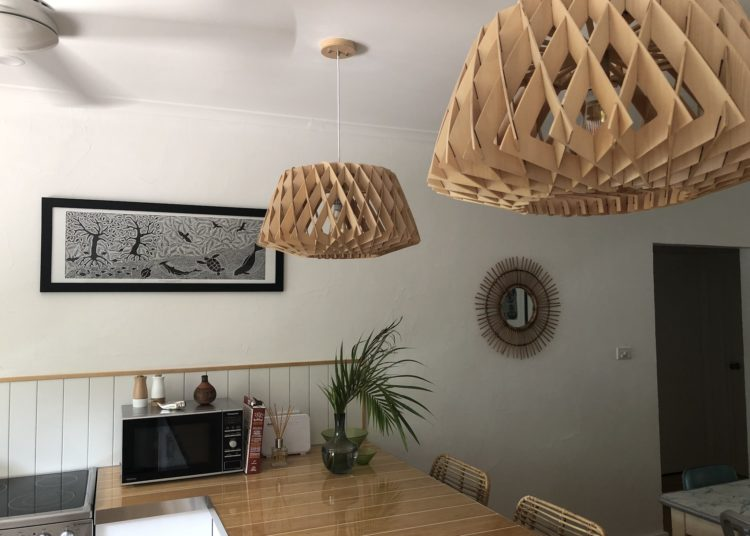 A photo of kitchen bench with artwork in shot